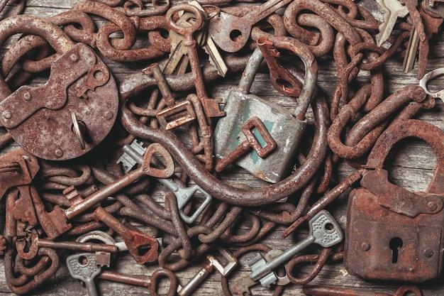 Old keys locks over vintage wooden table