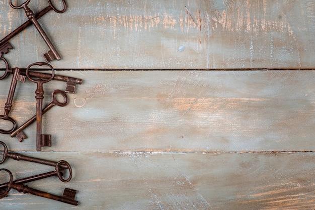 Old keys in wooden background