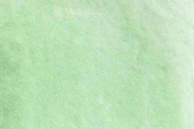 古いクラフトグリーンペーパーの背景のテクスチャ