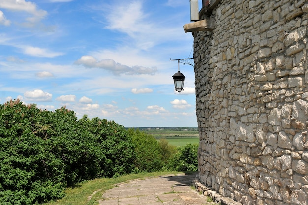 Old lantern on the stone wall of the old castle