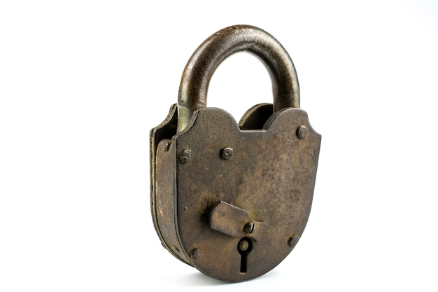 Old large rusty barn padlock closeup isolated on a white background.
