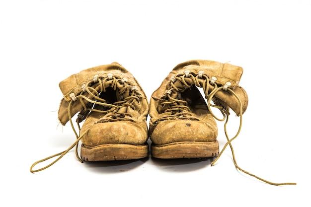 分離された白の古い革のブーツ
