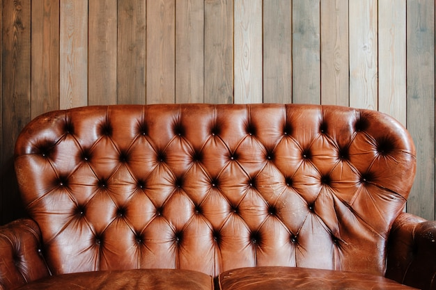 Old leather sofa with mosaic texture cover