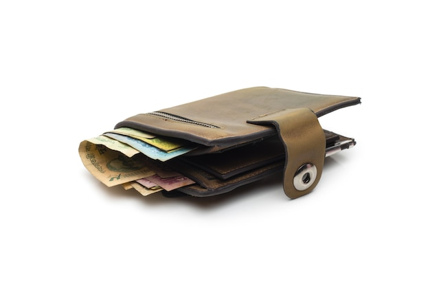 Old leather wallet with few bangladeshi banknotes on isolated white background