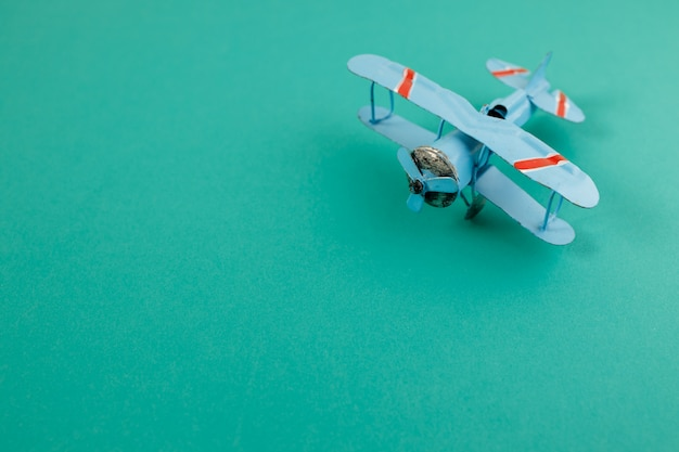 Old light aircraft toy with copyspace. travel concept
