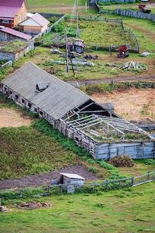 Old livestock farm top view russia mountain altai village of bichiktuboom