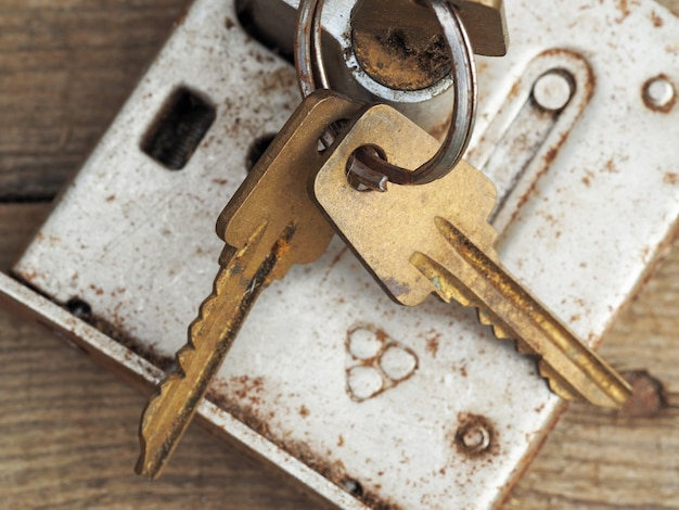 Old lock with keys covered with rust close up