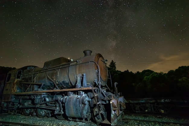 Old locomotive with  and milky way above it