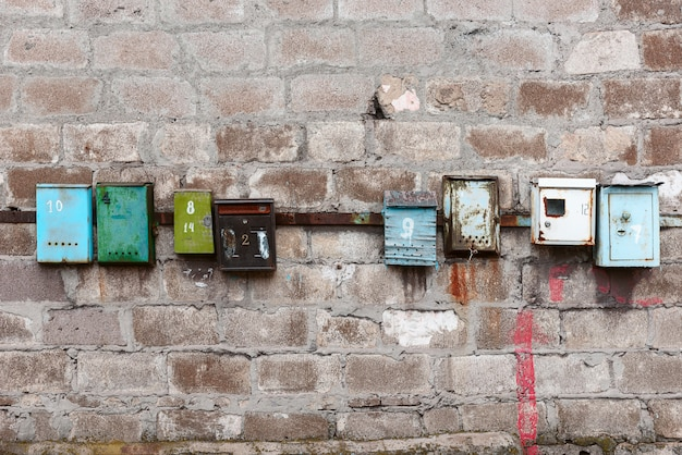 Old mailboxes on an old dirty wall