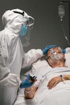 Old man breathing with a special equipment