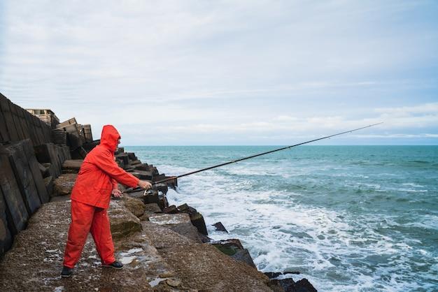 Old man fishing in the sea.