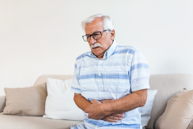 Old man having strong abdominal ache