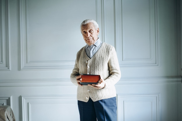 Old man holding a book