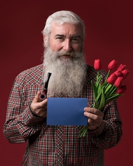 Old man holding flowers