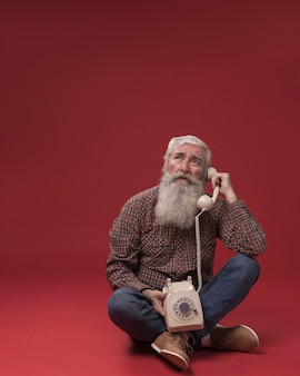 Old man holding a telephone