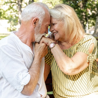 Old man kissing woman's hand