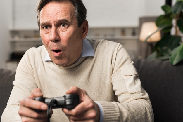 Old man playing videogame