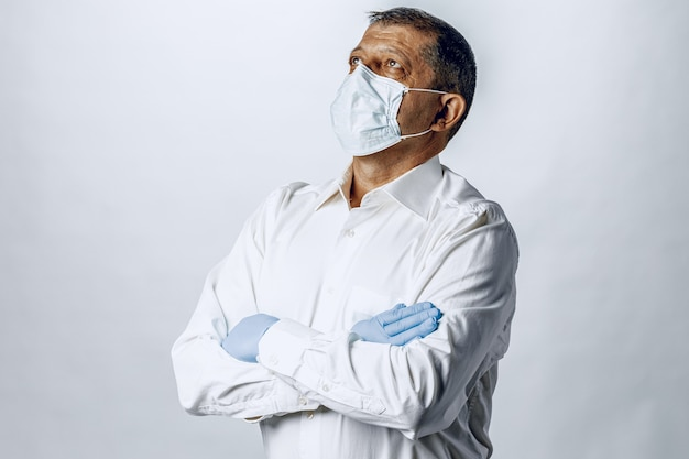 Old man wearing protective mask and gloves, close up.