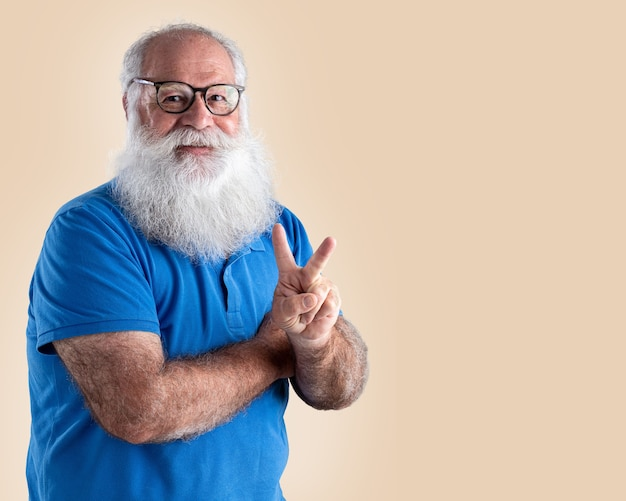 Old man with a long beard on a pastel background. senior with full white beard.