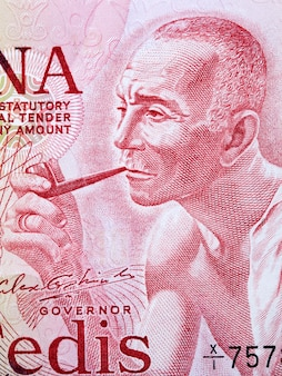 Old man with pipe a portrait from ghanaian money