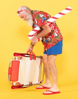 Old man with sunbed and candy cane
