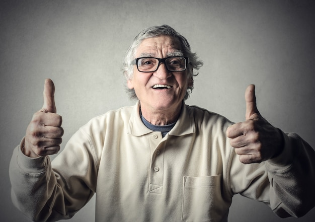 Old man with thumb up