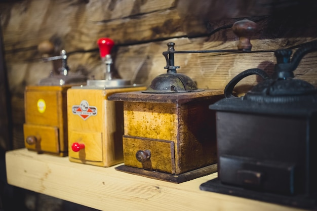 Old manual coffee mills on wooden table