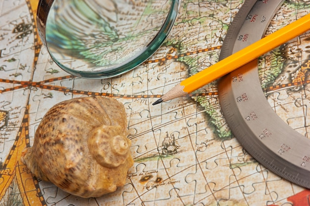 Old map and shell, still life