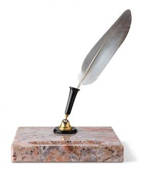 Old marble inkstand and quill isolated