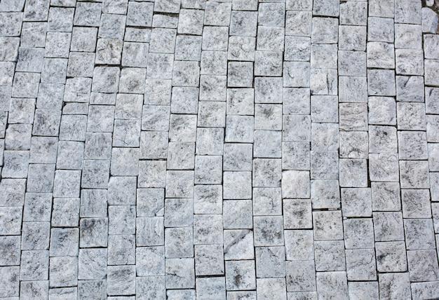 체코 프라하의 바닥에 있는 오래된 벽돌. 근접 촬영
