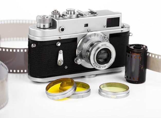 흰색 배경에 오래 된 기계 사진 카메라