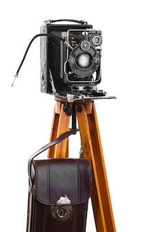 Old mechanical photo camera on a white background