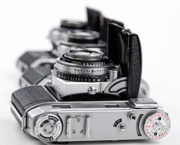 Old mechanical photo camera, on a white background