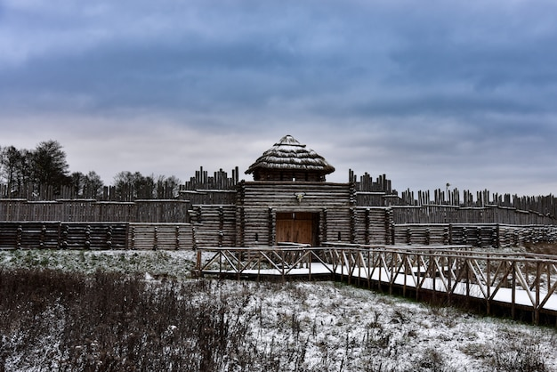 Old medieval wooden fortress in winter