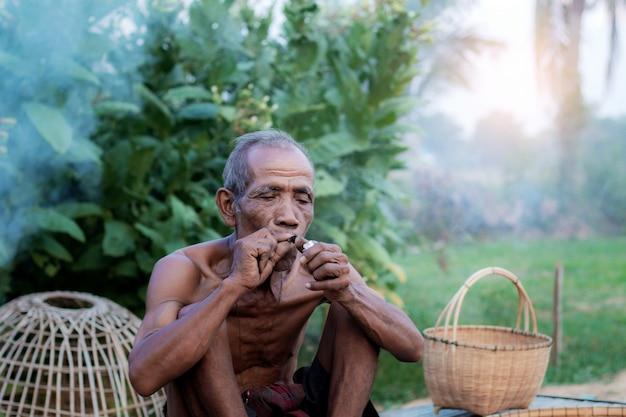 Old men are smoking and basket.