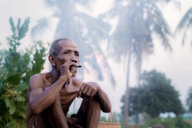 Old men are smoking.