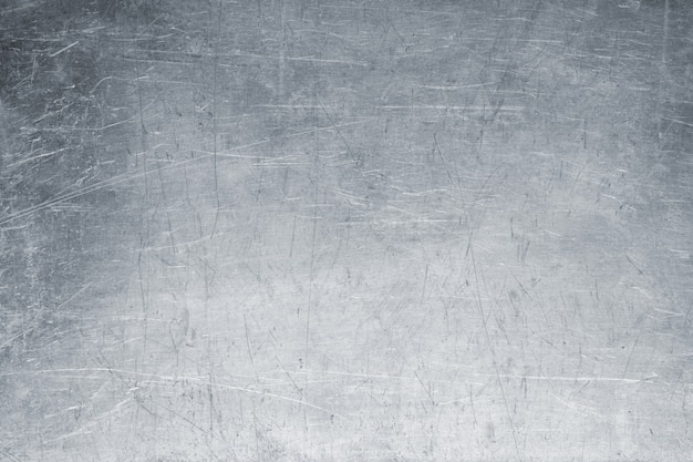 Old metal background, bright iron texture, worn brush or sandpap