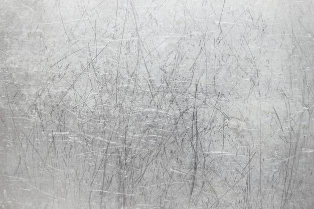 Old metal background, bright iron texture, worn brush or sandpaper
