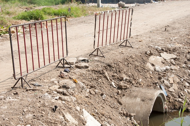 Old metal barriers for safety in construction site.