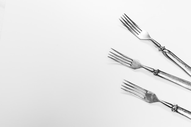 Old metal forks isolated on a white .