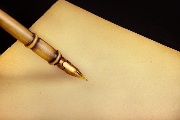Old metal pen and notebook in office