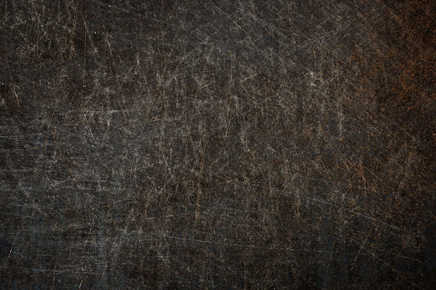 Old metal surface with scratches and rust background.