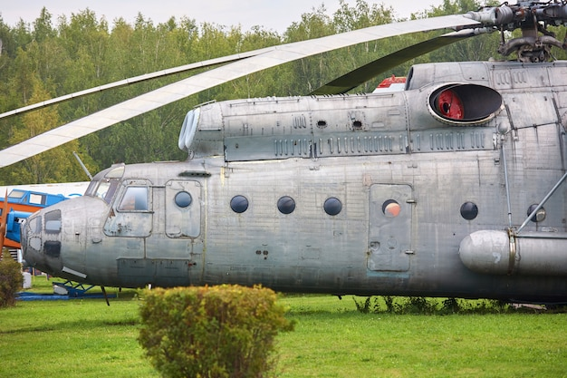 Old military helicopter painted in gray