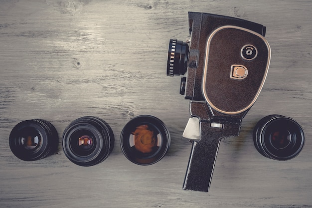 Old movie camera with lens