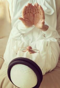 Old muslim man praying