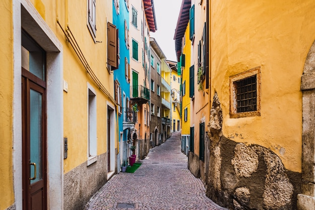 Old and narrow streets of beautiful typical italian colors on a winter day without tourists.