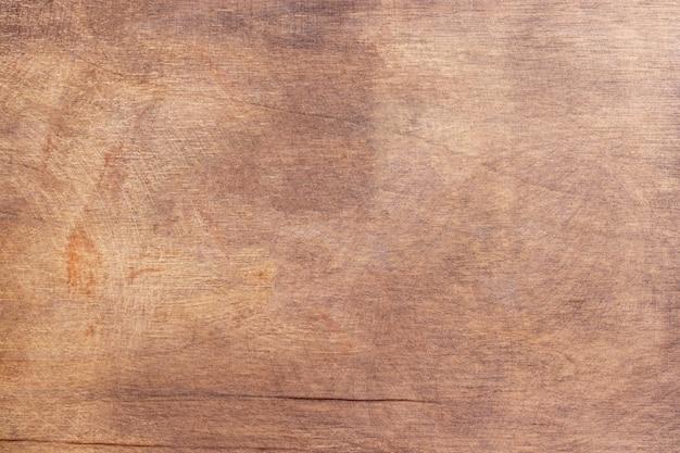 古い自然な木製の背景。傷のある素朴な壁。ぼろぼろの木の質感