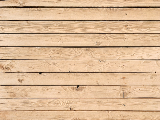 Old natural wooden plank background texture.