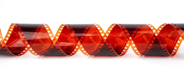 Old negative 35 mm film strip on white background strip of tangled camera film