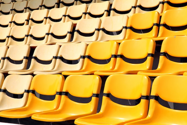 Old and new yellow seat in stadium